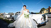 Bride with classic car